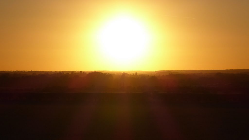 Silhouetted land sunset