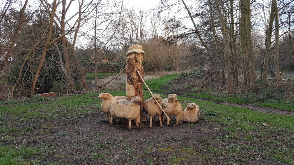 Shepherd and sheep sculpture